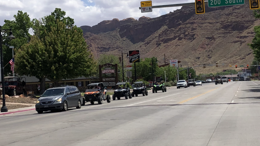 Photo of a line of ATVs on a street