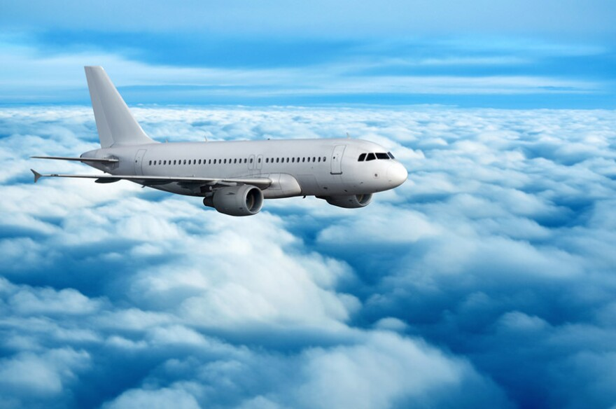 passenger-airplane-above-the-clouds.jpg
