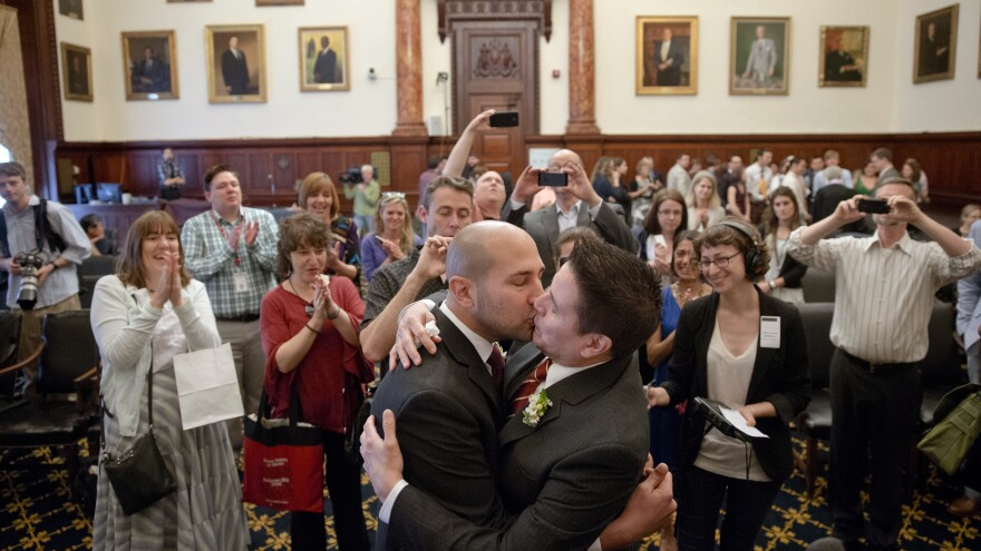 Christopher DiCapua, left, and Oscar Cabrera kiss after saying their wedding vows on Friday at City Hall in Philadelphia. On Tuesday, Pennsylvania became the final northeastern state and the 19th in the U.S. to legalize same-sex marriage.