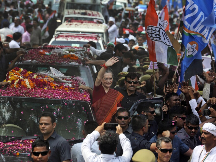India's opposition Congress party leader Sonia Gandhi (center) waves as she arrives to file her nomination papers for elections, in Rae Bareli, Uttar Pradesh, India, on Thursday. The Congress party dominated Indian politics for much of the country's history but has been overshadowed in recent years by the Hindu nationalist BJP.