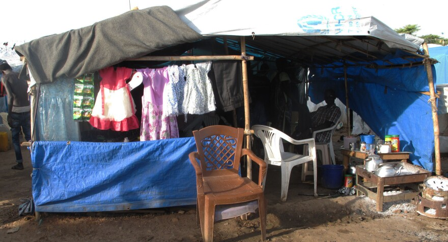 "A kiosk in the Juba camp sells girls' dresses. ""People buy it for a holiday,"" says the owner. Weddings are held in the camp as people are too scared to leave for fear they'll be targeted for their ethnicity."