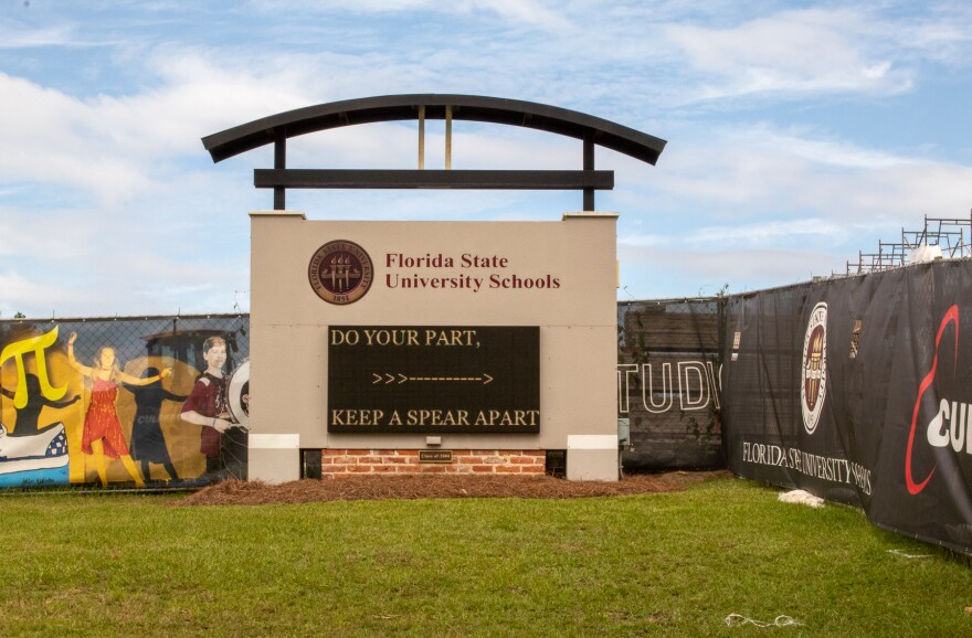 Florida State University Schools Sign on a green lawn and under a blue sky
