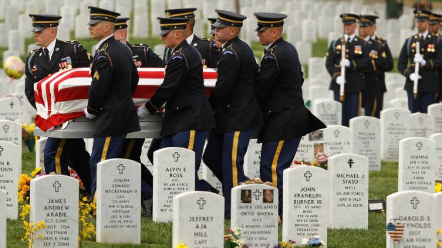 """April 20:  Soldiers from the U.S. Army 3rd Infantry Regiment, also called """"The Old Guard,"""" carry U.S. Army Corporal Justin Ross' flag-draped casket during his burial ceremony at Arlington National Cemetery. Ross, 22, of Green Bay, Wis., <a href=""""http://militarytimes.com/valor/army-cpl-justin-d-ross/6080161/"""">died March 26</a> in Helmand province, Afghanistan."""