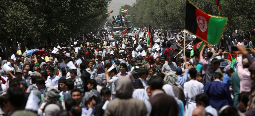Thousands of demonstrators march towards the center of Kabul, Afghanistan on Saturday.
