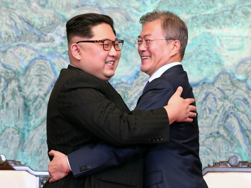 North Korean leader Kim Jong Un and South Korean President Moon Jae-in embrace after signing the Panmunjom Declaration for Peace, Prosperity and Unification of the Korean Peninsula during the Inter-Korean Summit at the Peace House on Friday.