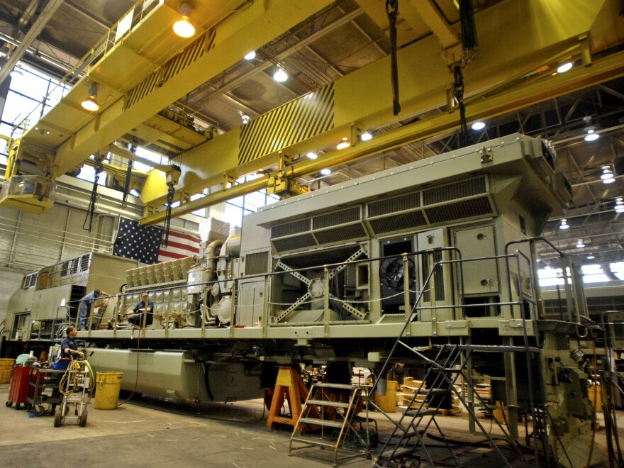 Workers assemble a General Electric Co. GE Transportation locomotive at the Erie, Pennsylvania, plant in 2009.