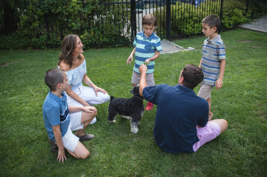 The Curran family (from left): Kyle, 9, Jessica, Conner, 9, Chris and Will, 7, with their dog Hunter, a miniature schnauzer. Pfizer is planning a much larger study for later this year of the same treatment Conner got, and other companies are now working on different types of gene therapy to treat Duchenne muscular dystrophy.