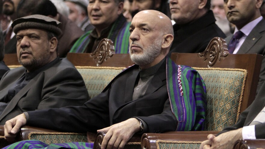 Afghan President Hamid Karzai attends the Loya Jirga in Kabul on Sunday.
