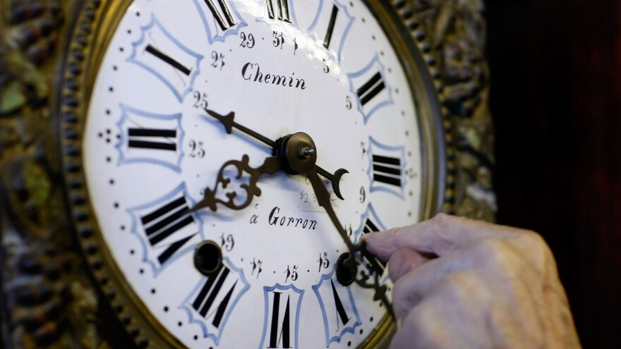 A man adjusts his clock during daylight saving time. The Norwegian island of Sommaroy, which sits north of the Arctic Circle, enjoys  unending sunlight from May 18 to July 26, and its residents argue that time is meaningless there.