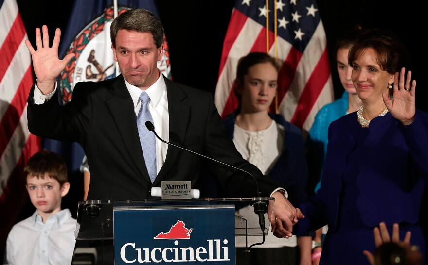 Virginia Attorney General Ken Cuccinelli, appearing with his family, waves goodbye to supporters after conceding the Virginia governor's race to Terry McAuliffe. Cuccinelli's stronger-than-expected run became the dominant story on Election Night.