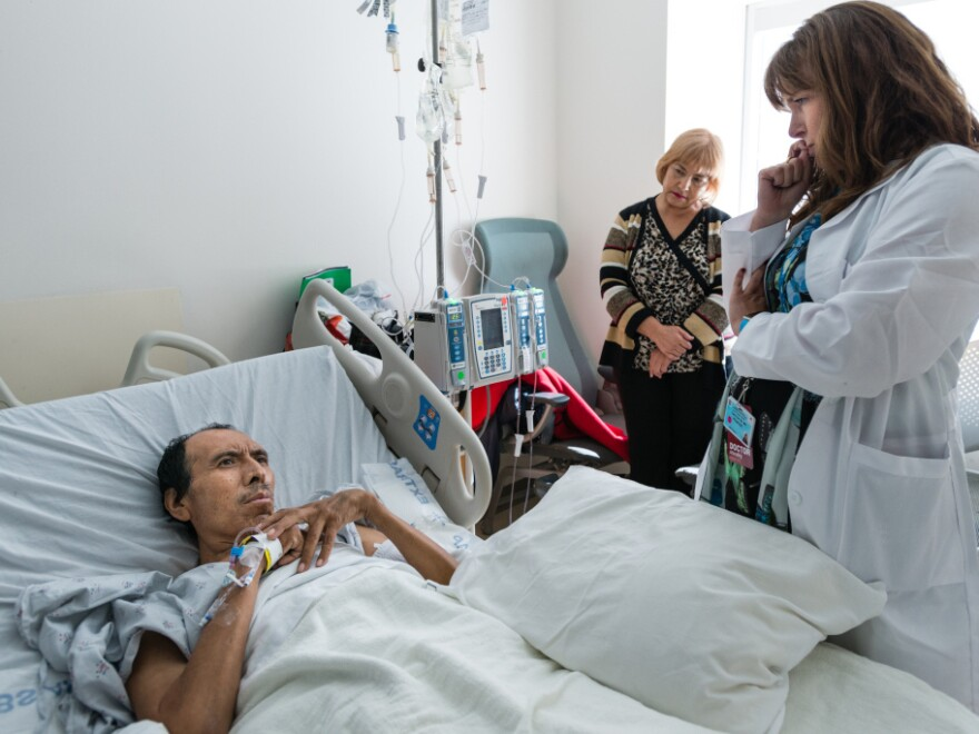 Dr. Carin van Zyl talks to patient Jose Garcia Flores about his treatment options for his advanced stage colon cancer in October.