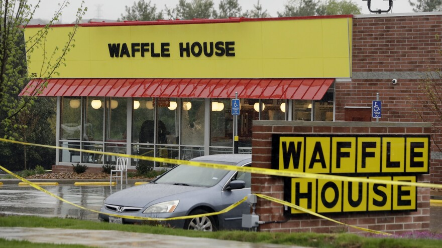 Police tape blocks off a Nashville, Tenn., Waffle House restaurant where at least four people died after a gunman opened fire early Sunday.