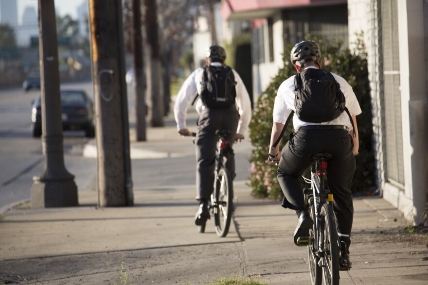 Photo of missionaries on bikes.