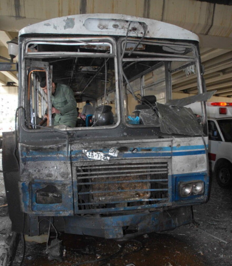 Syria's official news agency distributed this photo of a bus said to have been damaged by today's explosion in Damascus.