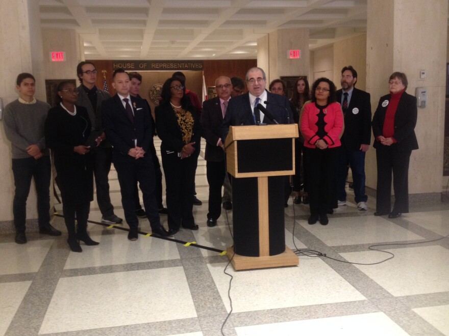 Joined by others, Rep. Joe Geller (D-Dania Beach) speaks during a press conference about a bill he filed.