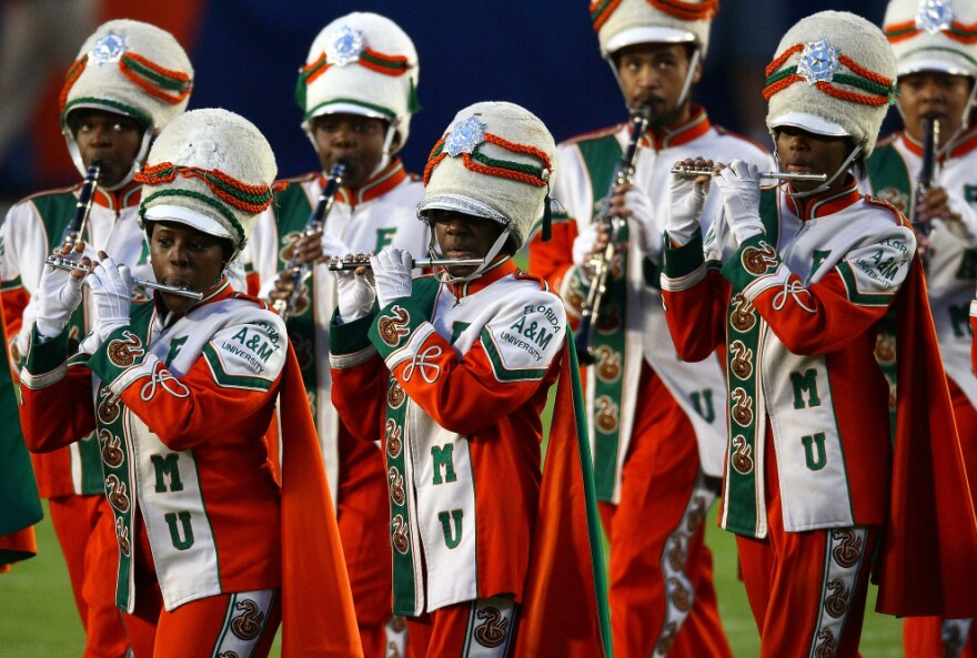 The Marching 100, Florida A&M University's band, performs on the field before Super Bowl XLIV, Feb. 7, 2010. The band's director, Julian White, was fired in November after a band member died, allegedly from a hazing incident on a bus.