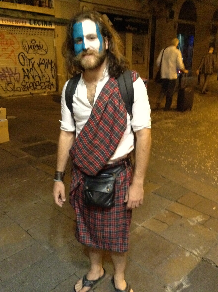 "Gabriel Herredero wears a kilt in downtown Barcelona to celebrate Scotland's independence referendum. ""For one day, I would like to be Scottish,"" he says."