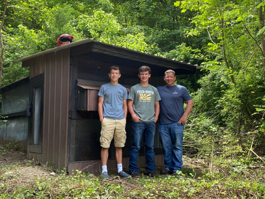 "Frank Martin (right) stands with his two sons, Jace (left), and Max (center), in front of their chicken coop. The three built the chicken coop as a ""quarantine project"" while Martin's sons were home from school because of the Coronavirus pandemic."