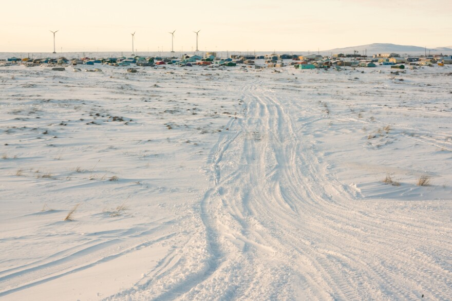 ATV and snow machine tracks lead from the airstrip to the village in Toksook Bay. Census Bureau officials crossed the tundra by plane to reach the fishing village along the Bering Sea in January.
