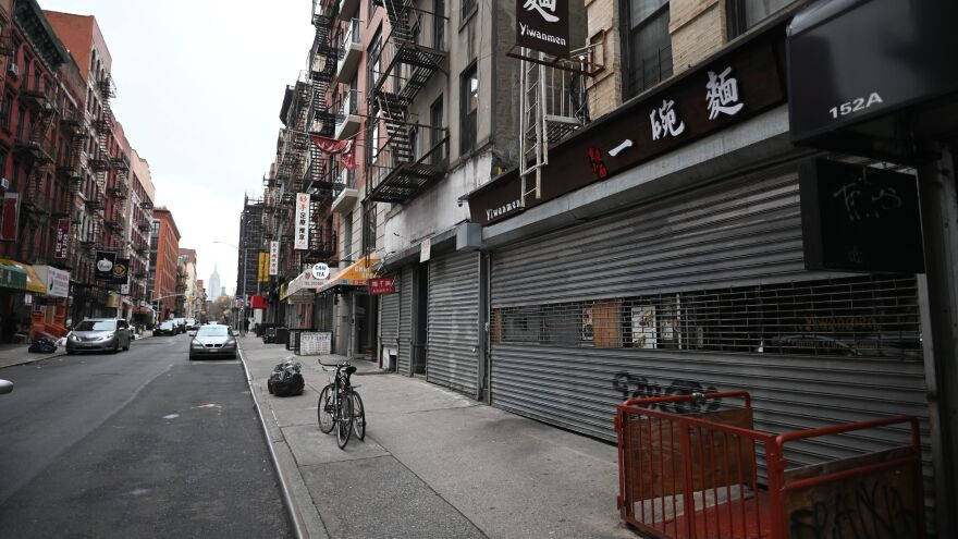 Closed shops are seen in Manhattan's Chinatown on March 17 in New York City. The path to reopening stores will be complex, the head of the U.S. Chamber of Commerce says.