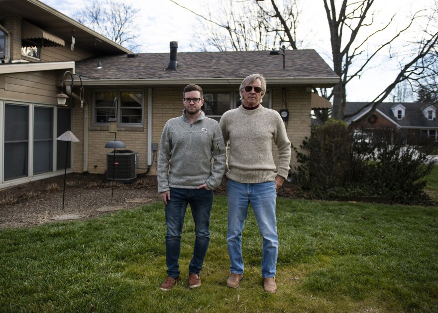 Scott Williams (right) and his son, Andy Williams, stand outside Scott Williams' home in Lebanon, Ind. Scott Williams lost his wife Debbie in April to hypothyroidism. The family has yet to have a proper funeral due to the pandemic.