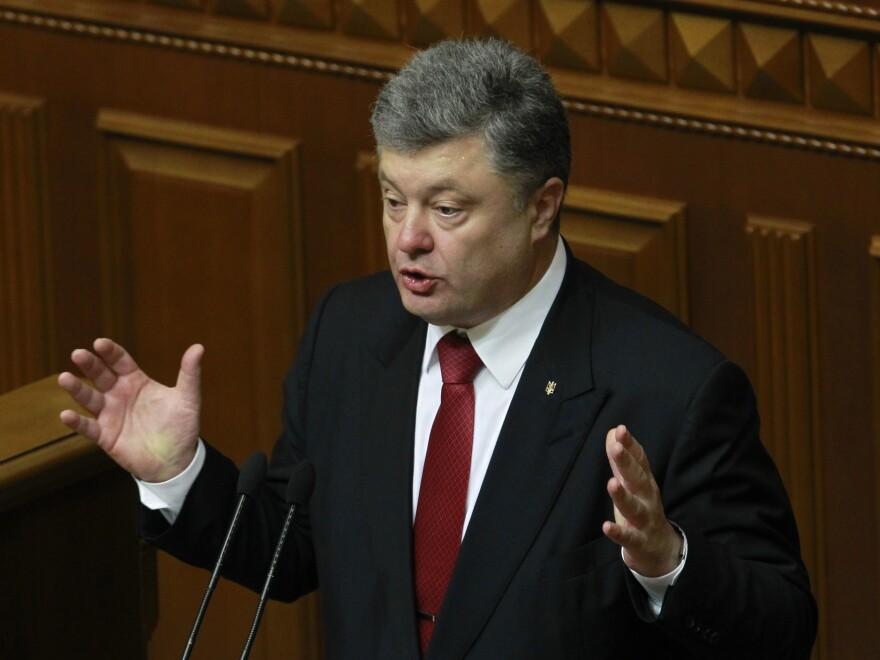 Ukraine's President Petro Poroshenko speaks to lawmakers during the annual address to the Parliament of Ukraine in Kiev, on Thursday.