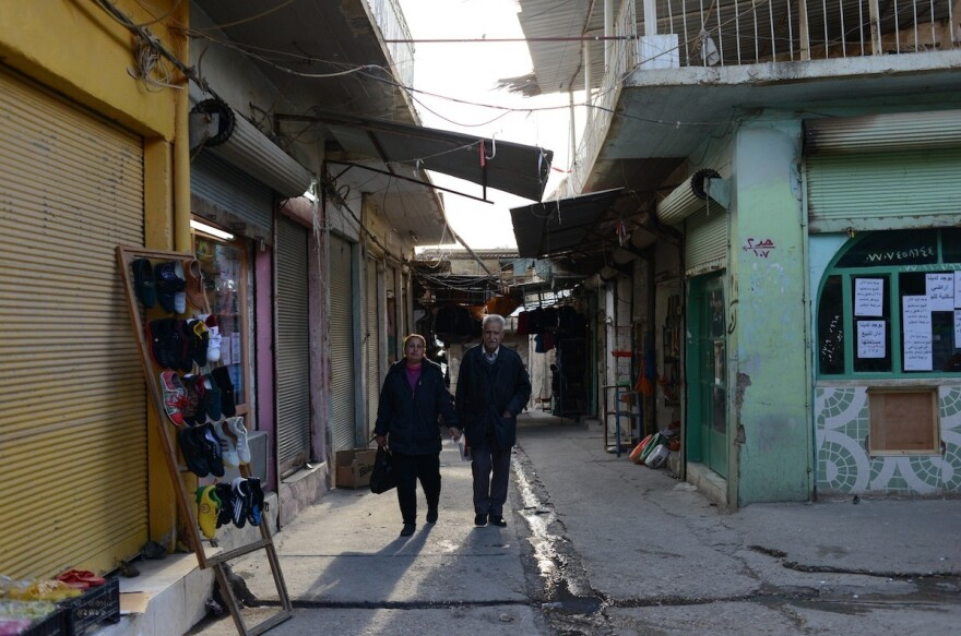 An Assyrian Christian couple walks through the market area of al-Qosh, where most residents have returned after fleeing last August in the face of an advance of the Islamic State. The ancient village is about 30 miles north of Mosul, Iraq's second biggest city, which is still held by the Islamic State.