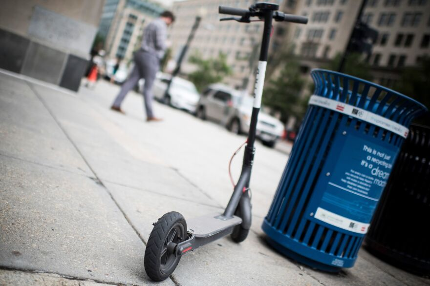 A Bird electric scooter found parked on a sidewalk in Washington, D.C. Pedestrian advocates are concerned about scooters blocking sidewalks.