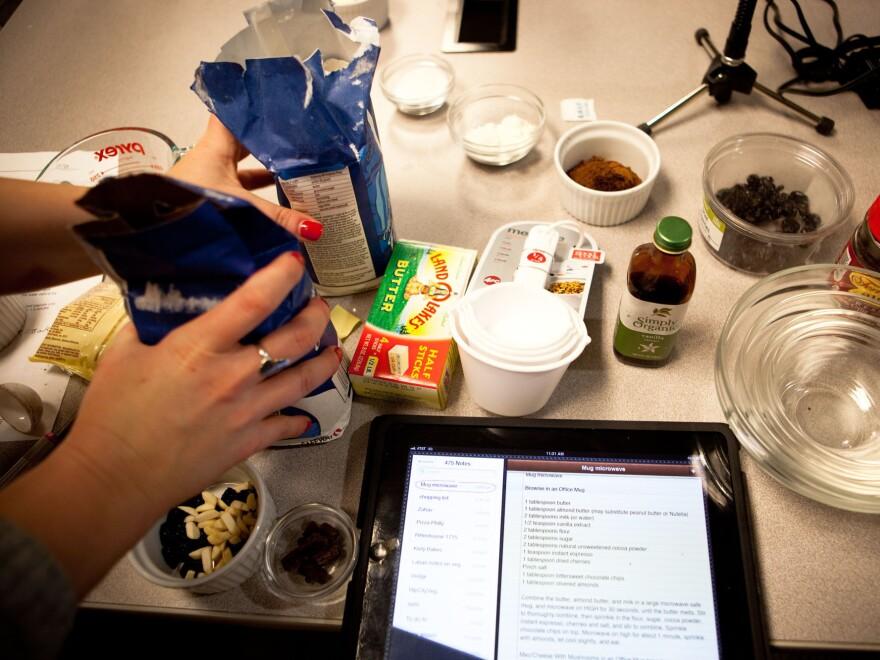 <em>Morning Edition</em> producer Rachel Ward preps the ingredients for a microwave creation.