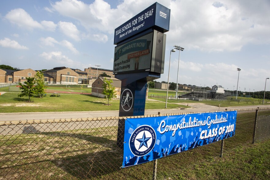 A sign outside the Texas School for the Deaf congratulates the graduating class.
