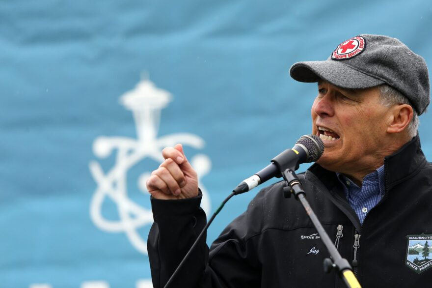 Washington state Gov. Jay Inslee speaks at a rally during the March for Science at Cal Anderson Park on April 22, 2017 in Seattle. Participants were advocating for science that upholds the common good and for political leaders and policy makers to enact evidence-based policies in the public interest. (Karen Ducey/Getty Images)