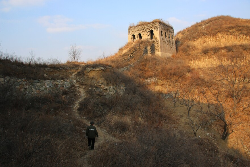 Qiao Guohua patrols a 5-mile stretch of the Great Wall of China. Roughly a third of the wall's 12,000 miles have crumbled to dust, and saving what's left may be the world's greatest challenge in cultural preservation.