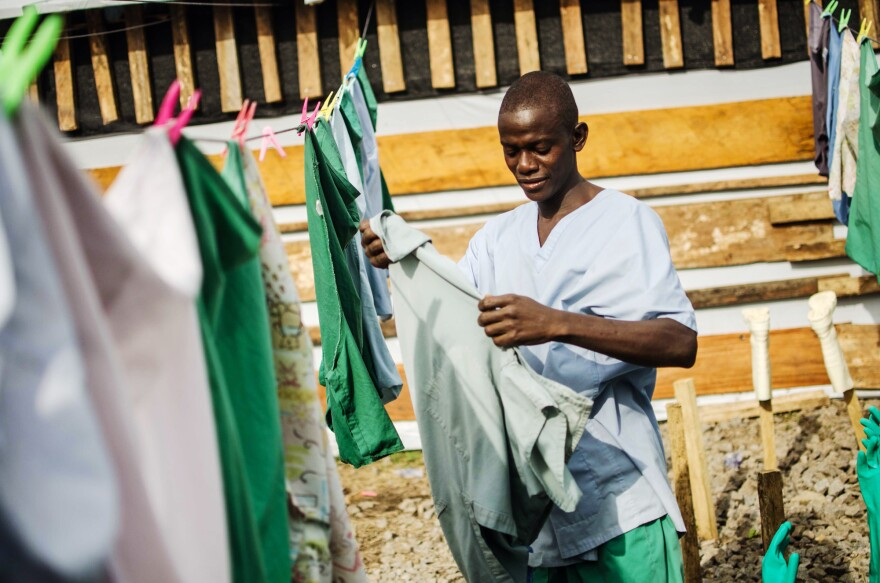 Morris Nyumah wanted to help his country fight Ebola, so he signed up to work as a hygienist at the Doctors Without Borders care center in Lofa County.