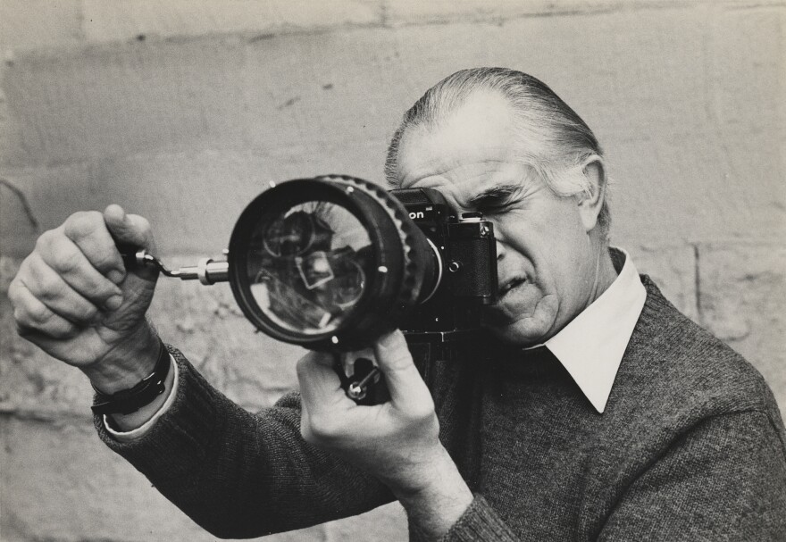 David Douglas Duncan looking through camera fitted with prismatic lens. Duncan, who died Thursday in the south of France at age 102, was one of the greatest photojournalists of the 20th century.