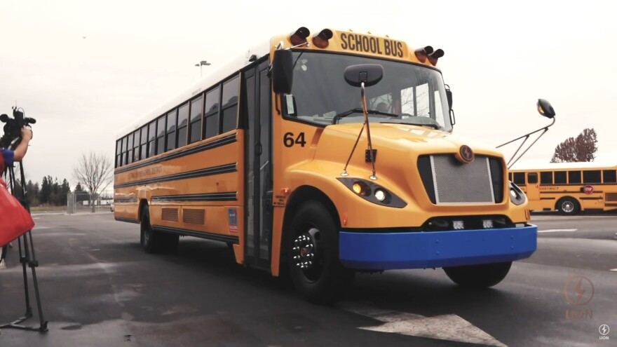A LionC electric school bus is pictured. According to the manufacturer, the zero-emission bus can be equipped with a range of up to 155 miles per charge.