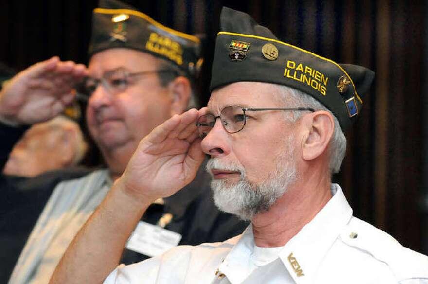 Veteran saluting off camera