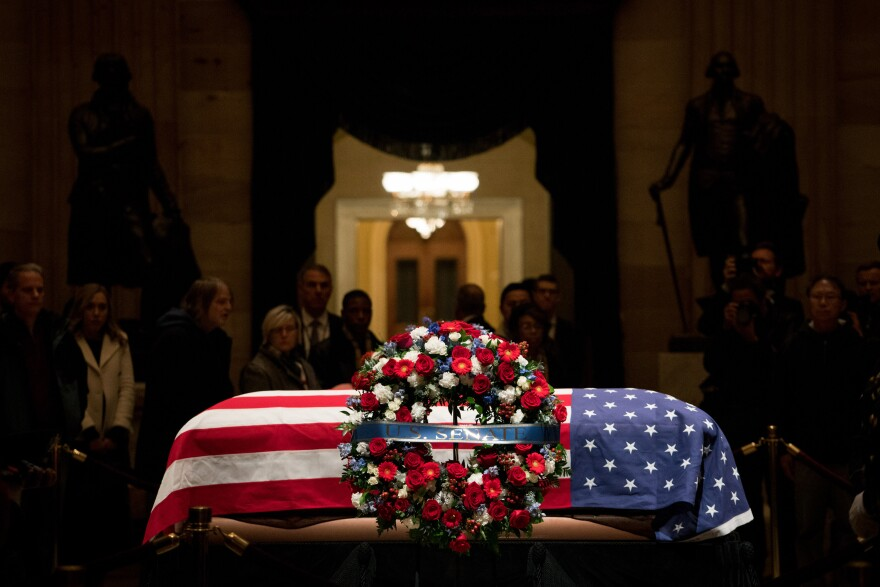 "Bush was eulogized during a Capitol ceremony by Senate Majority Leader Mitch McConnell, who called him ""a humble servant who loved his fellow citizens."""