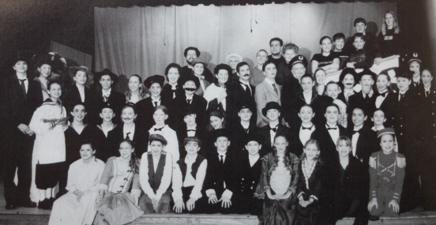 """The cast and crew of <em>Titanic</em>, as pictured in my 2001-2002 yearbook. I'm standing in the third row back on the right side, in front of the """"captain."""""""
