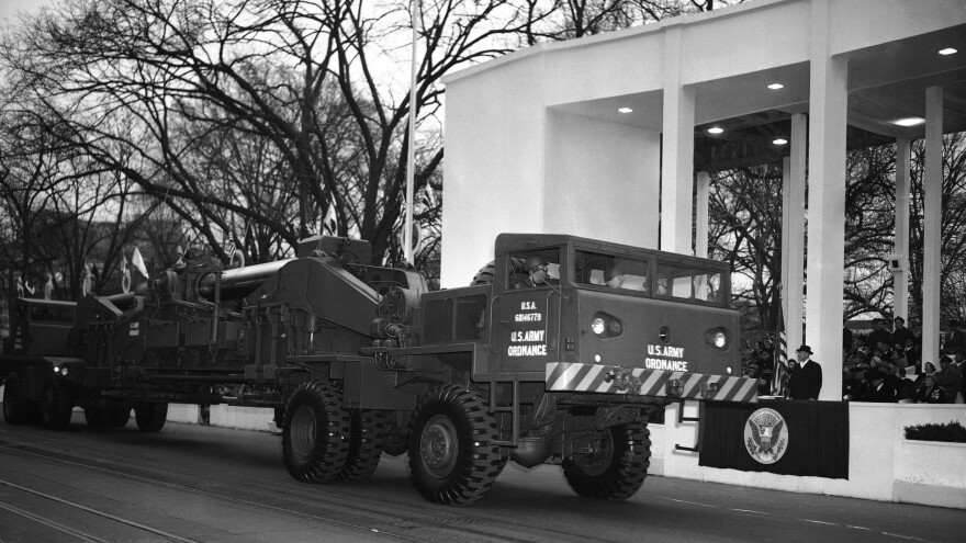 The Army's atomic cannon is hauled past the presidential reviewing stand during the inaugural parade for President Dwight Eisenhower (at right), Jan. 20, 1953.