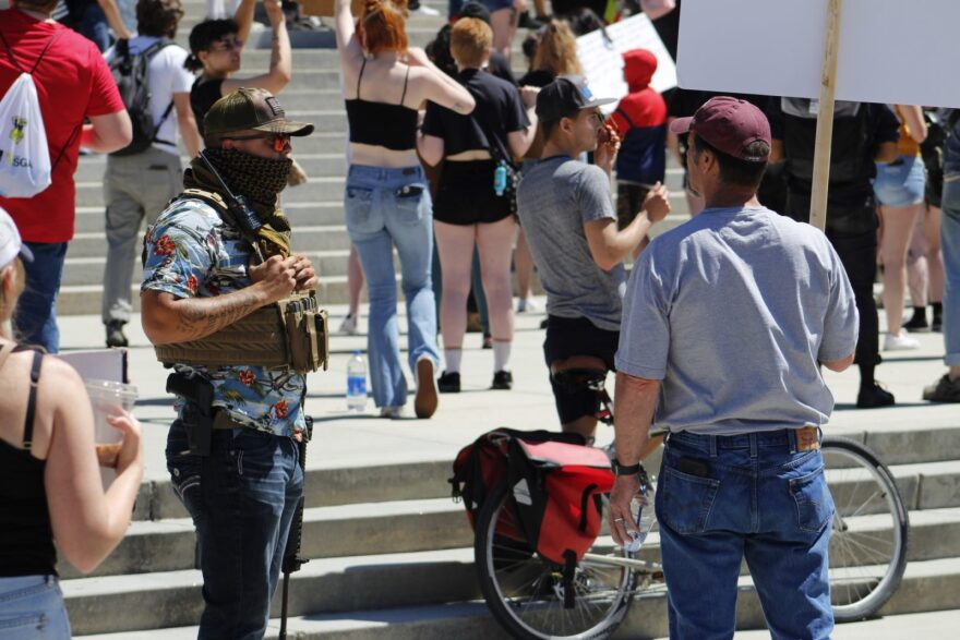 An armed counterprotester stands at a Black Lives Matter rally in Boise, Idaho, on May 31.