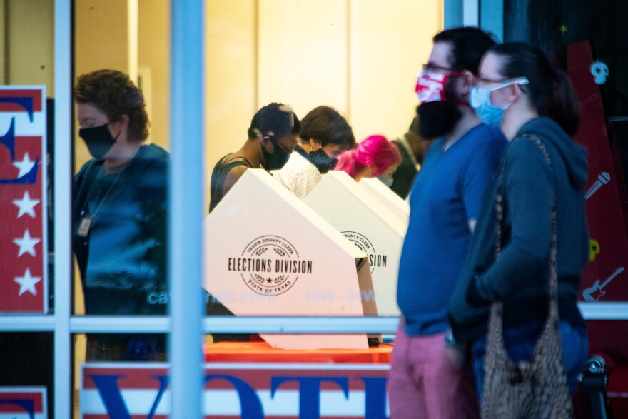 Travis County residents vote at the Southpark Meadows shopping center during early voting.