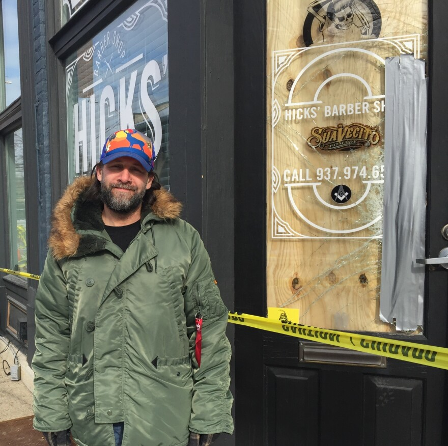 James Hicks stands in front of his business, which could remain closed for several months.