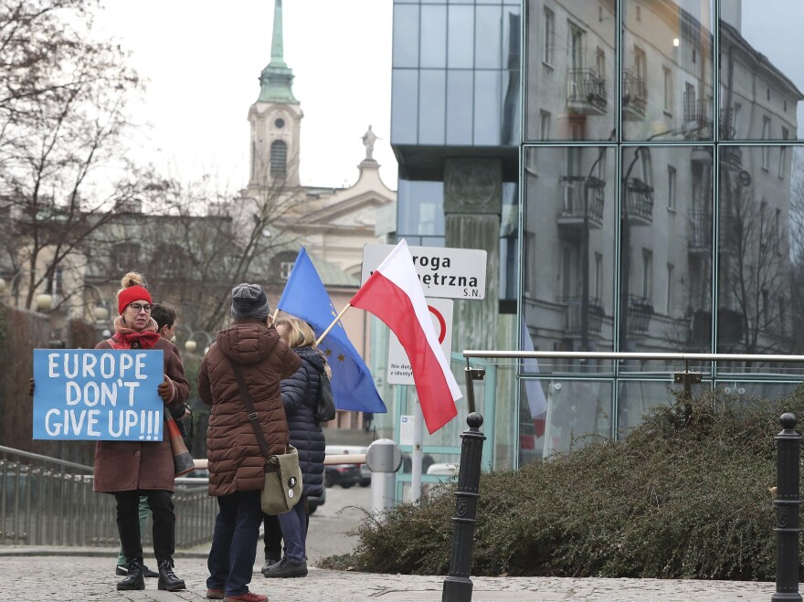Protesters gather outside Poland's Supreme Court in January, demonstrating against the government's efforts to curtail the judiciary's independence. The European Commission is investigating Poland and Hungary for violating standards of democracy and rule of law.