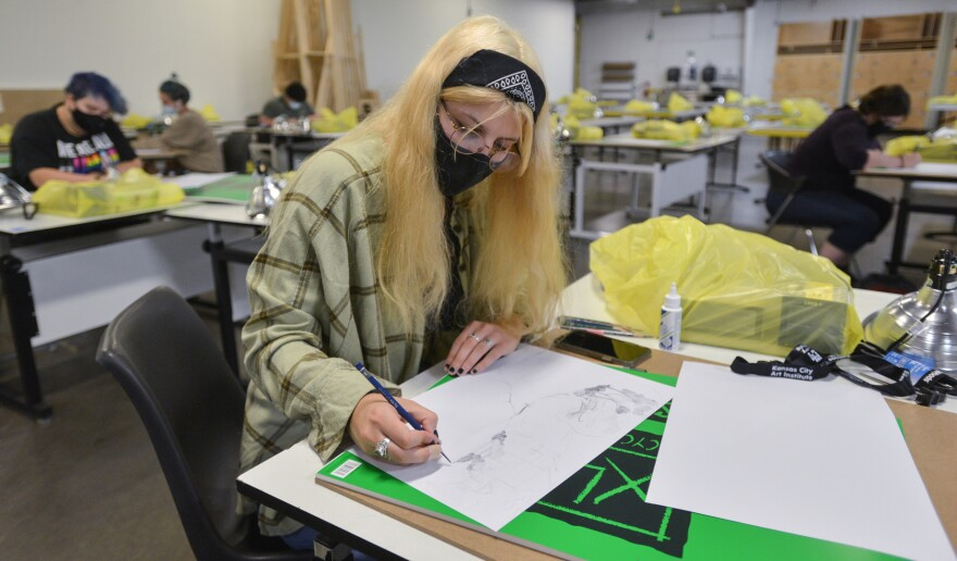 Freshman student drawing her first assignment in Hugh Nerrill's foundation studio class.