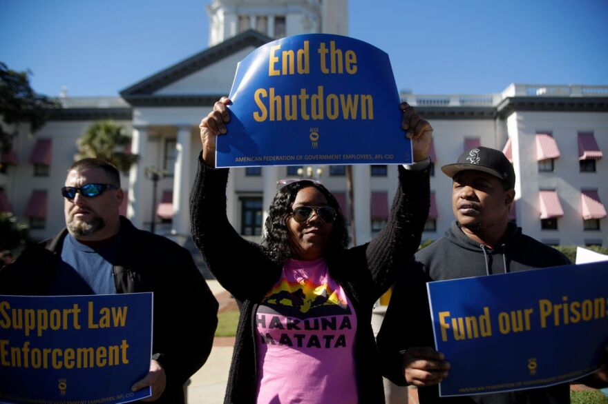 Federal prison employees and other federal workers held a rally in Downtown Tallahassee Thursday, amid having their paychecks halted as a result of the ongoing U.S. Government shutdown.