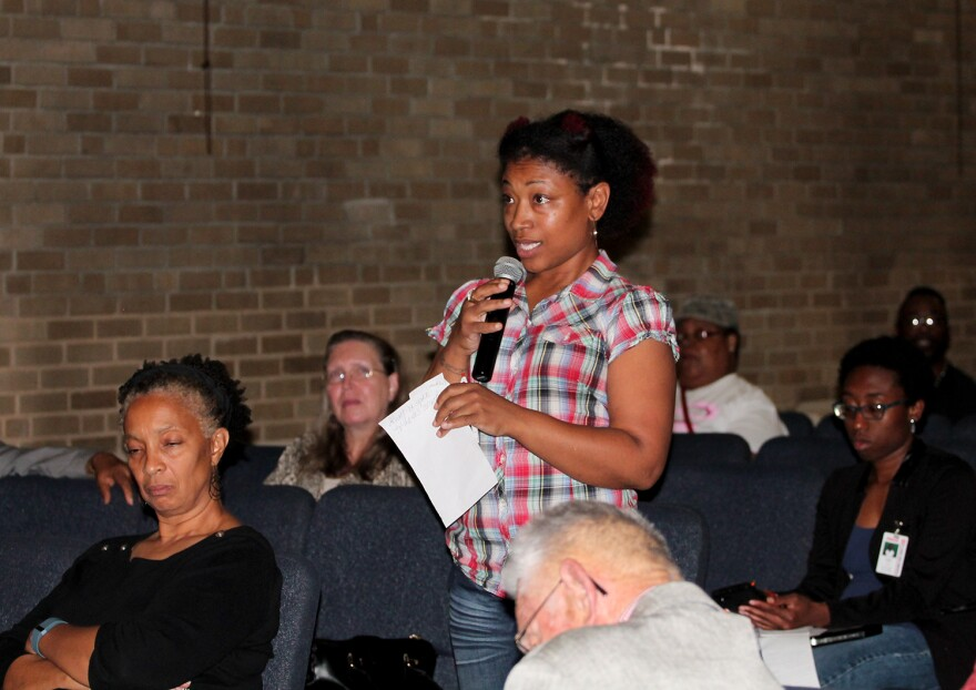 Ferguson resident Shirlissa Pruitt asks about keeping more resources in her part of the school district  at a town hall meeting on Thursday. Sept. 22, 2016.
