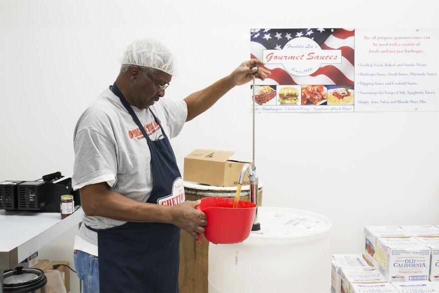 Freddie Lee James, owner of Freddie Lee's Gourmet Sauces, prepares a batch of his mild sauce on Dec. 18, 2019 in St. Louis.