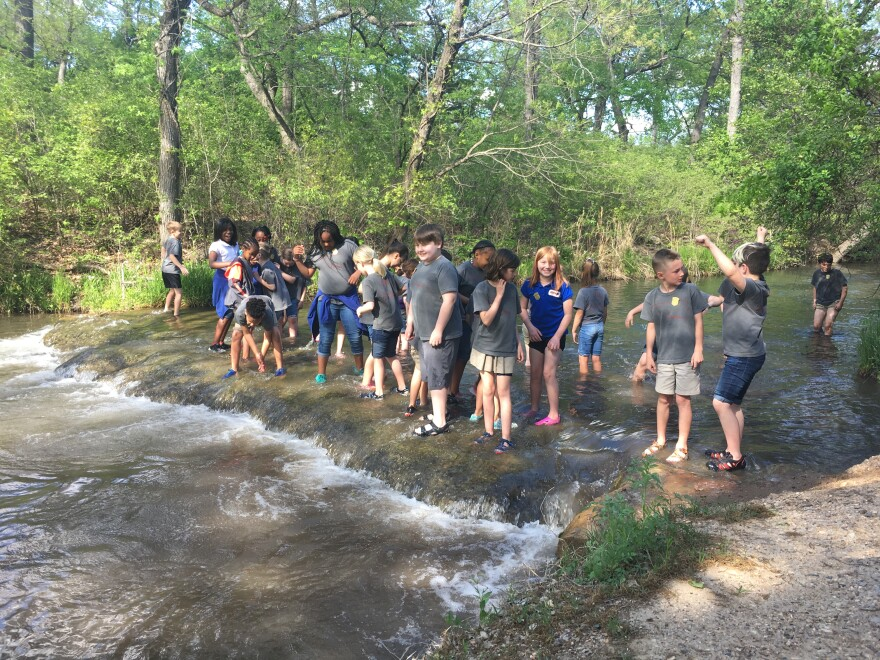 Elementary school students play in the water at the Chickasaw National Recreation Area near Sulphur, Oklahoma. After the state of Oklahoma experienced an extended drought in 2011-2012, officials put together a drought mitigation plan for this region.