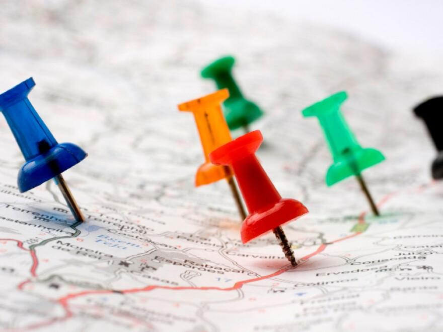 Thumbtacks on a map.