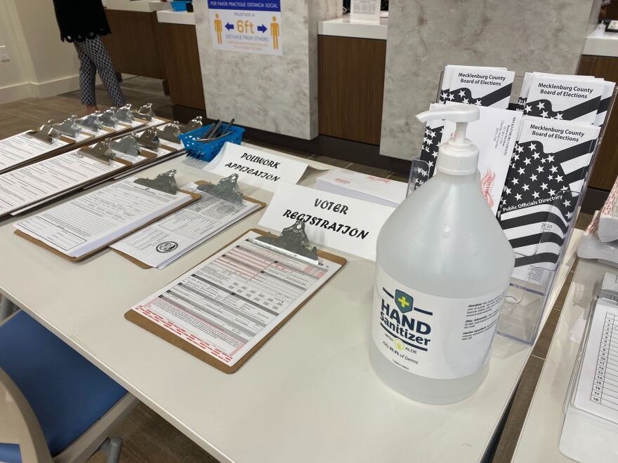 Application forms and hand sanitizer at the Mecklenburg County Board of Elections on Kenilworth Avenue.